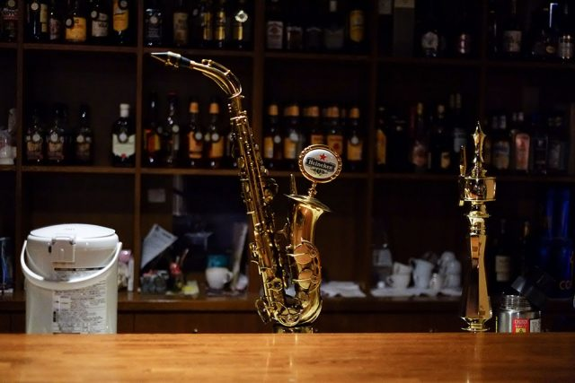 A real alto saxophone turned into a beer server. Neat stuff you only find in jazz bars.